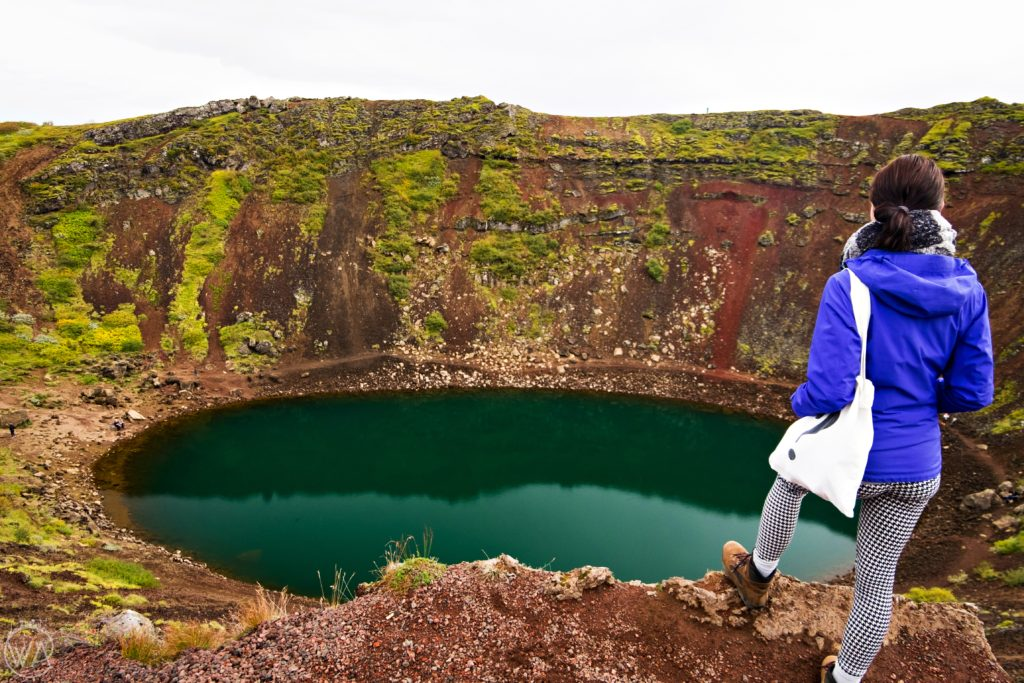 Girl in front of Kerið volcanic crater lake