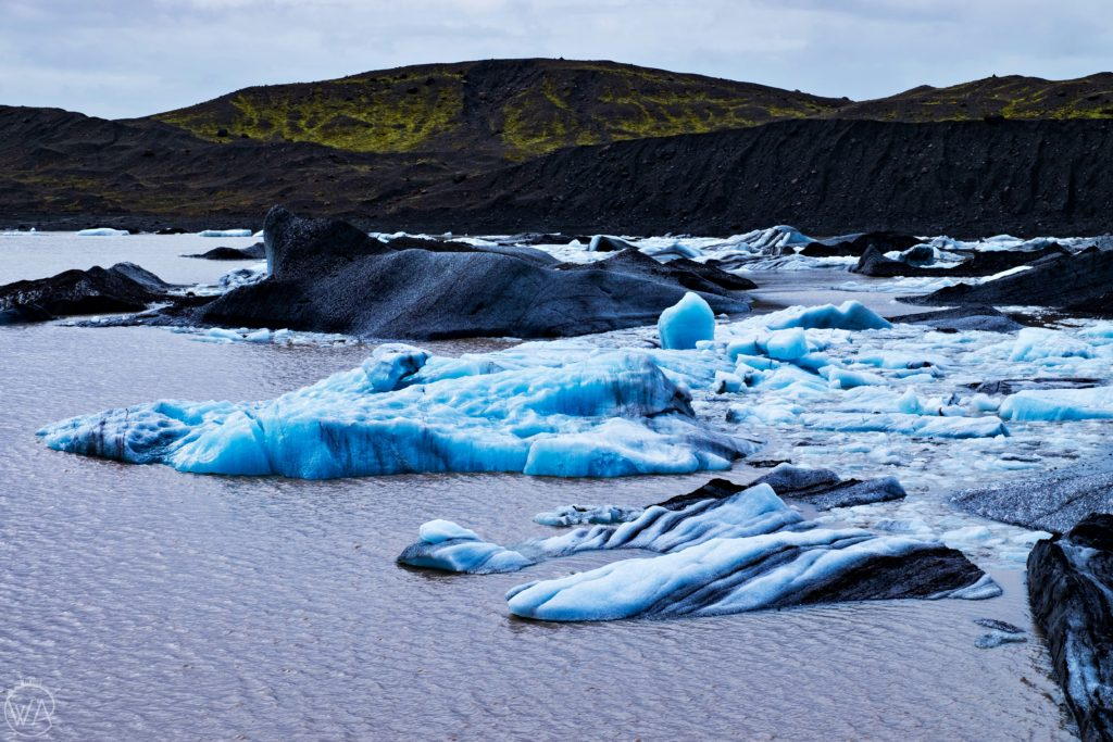 Iceland off the beaten path with hidden gems map - Pieces of blue ice in Svínafellsjökull glacier Iceland