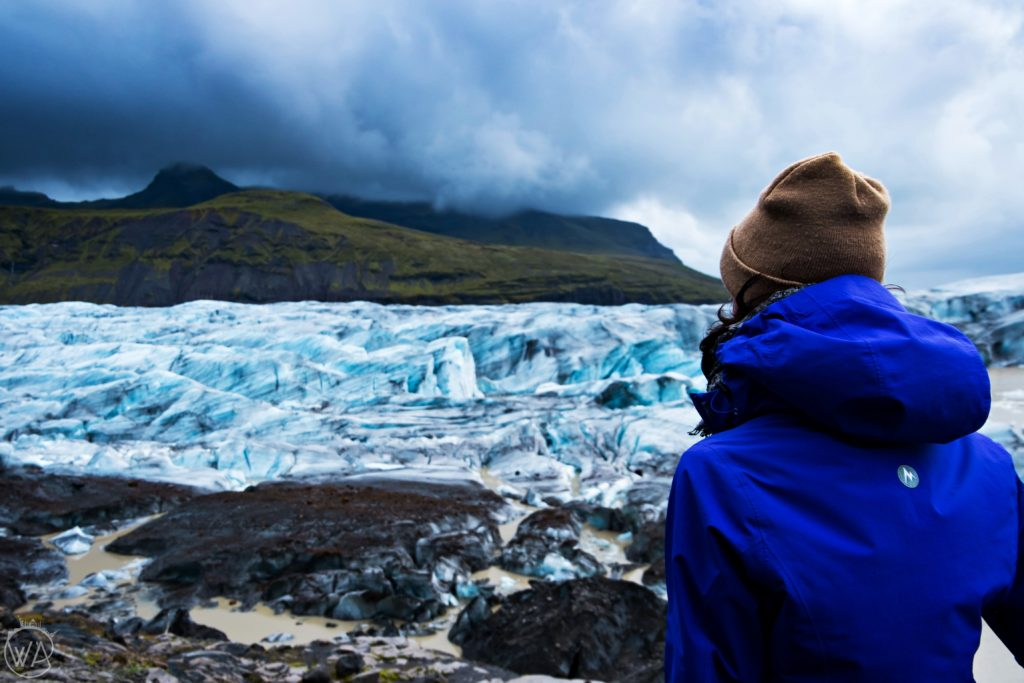 Girl looking at Svínafellsjökull glacier Iceland