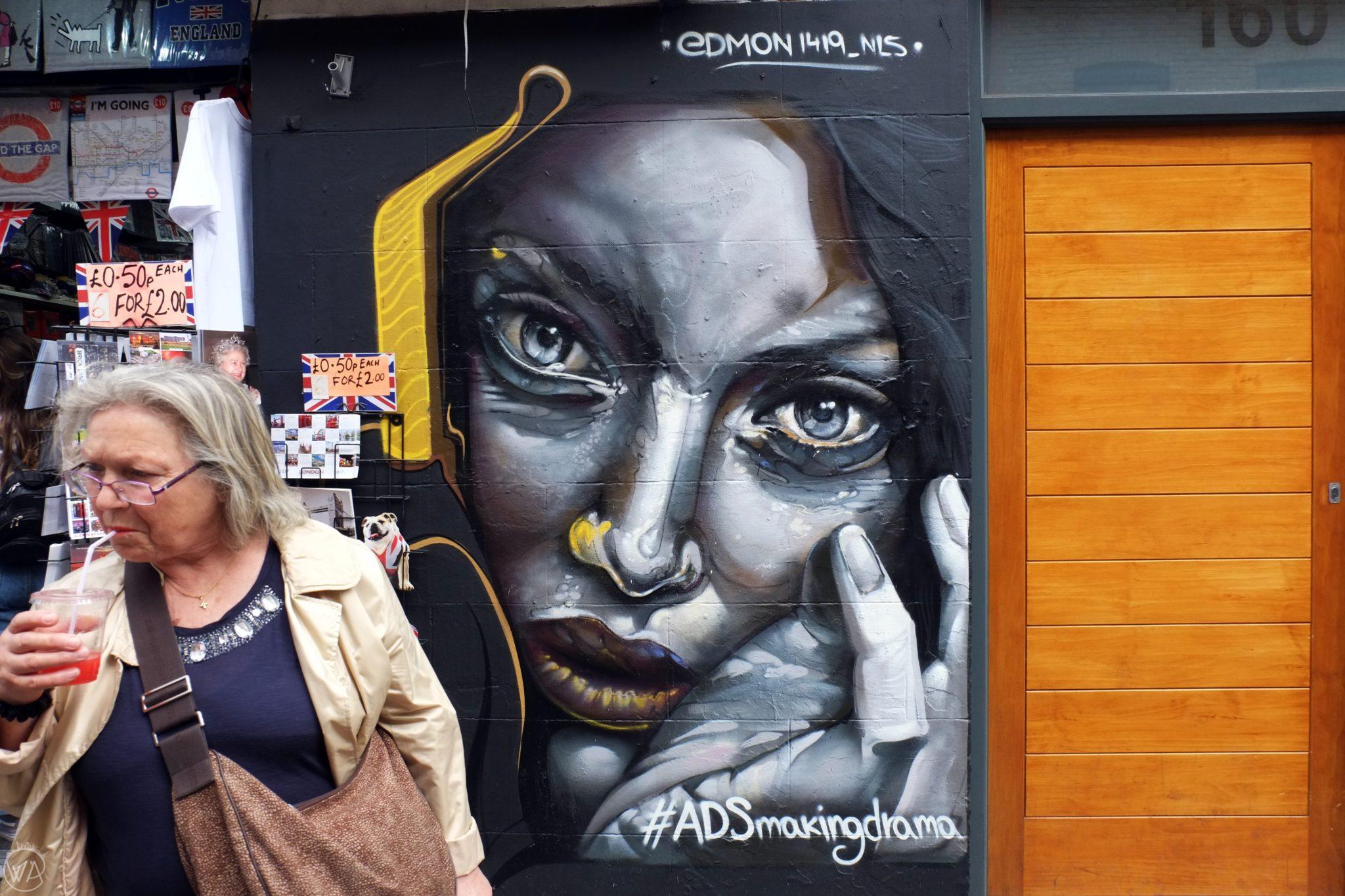 Woman and street art woman Brick Lane, London