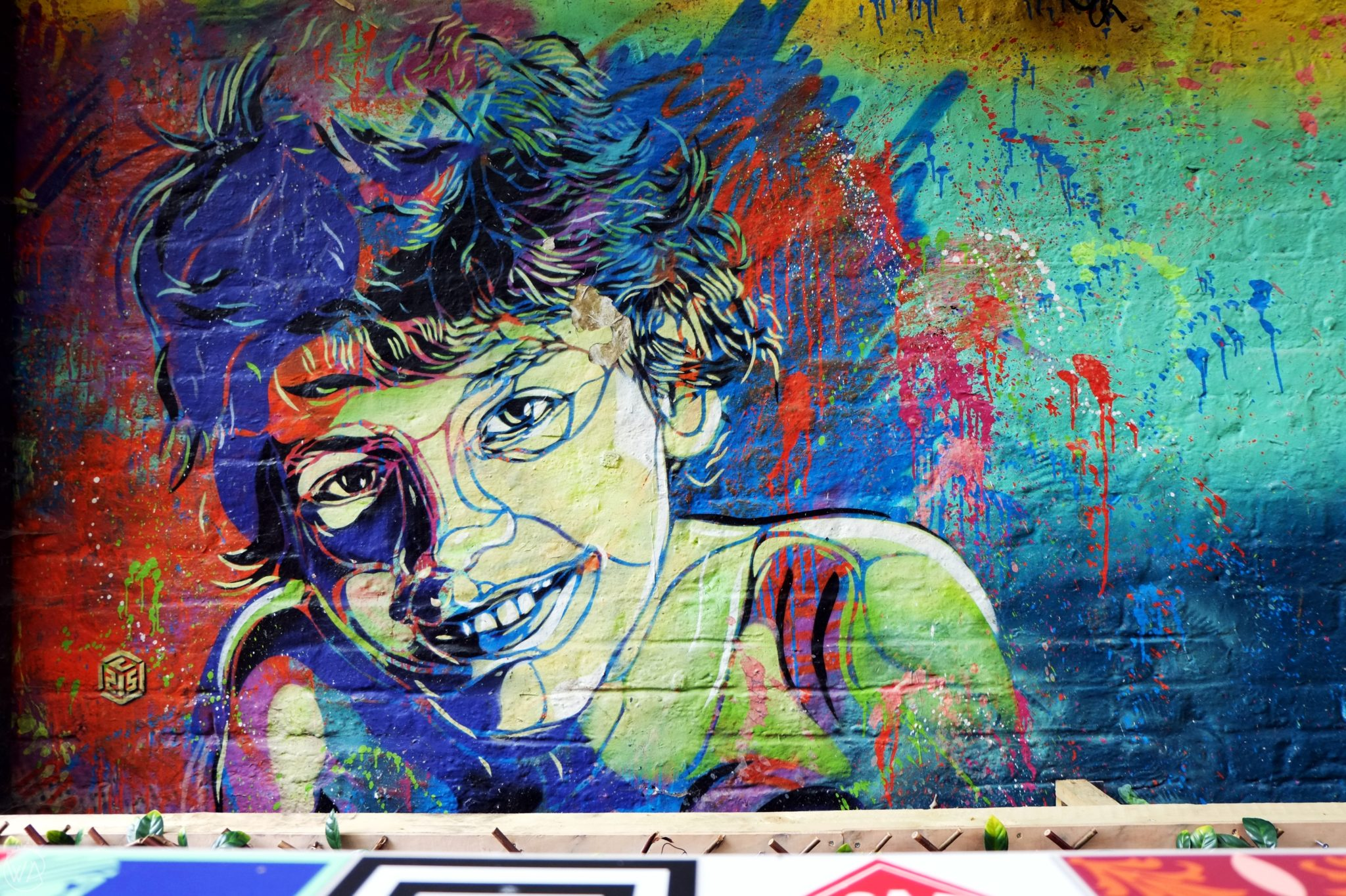 C215 portrait street art Brick lane London