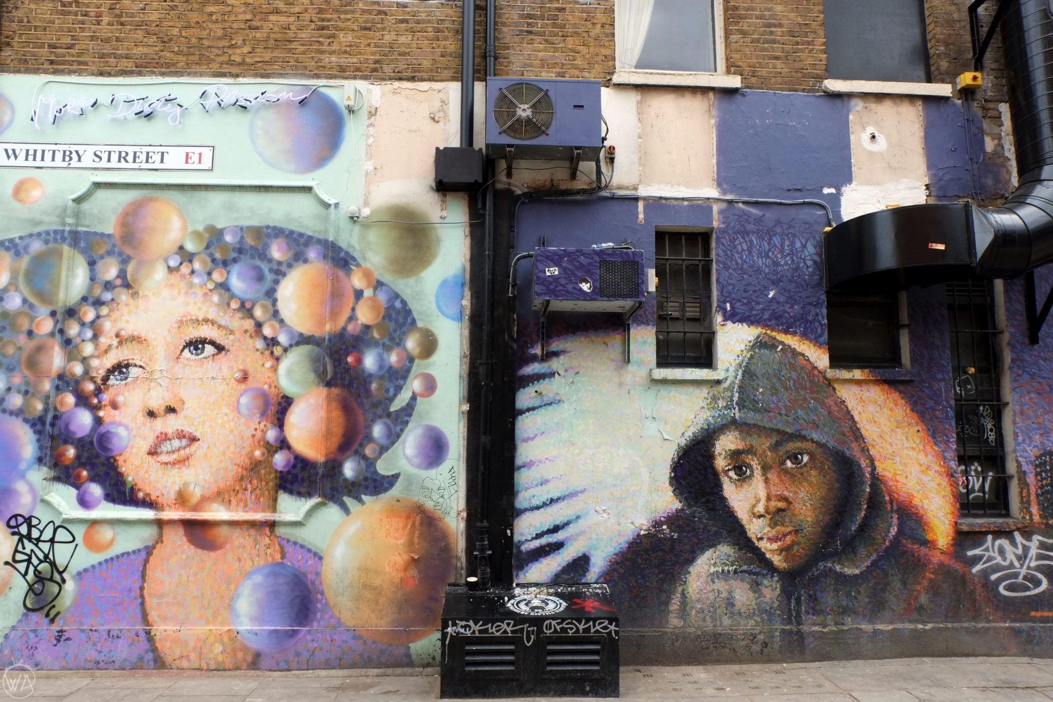 Street art of a woman and boy, brick lane, London