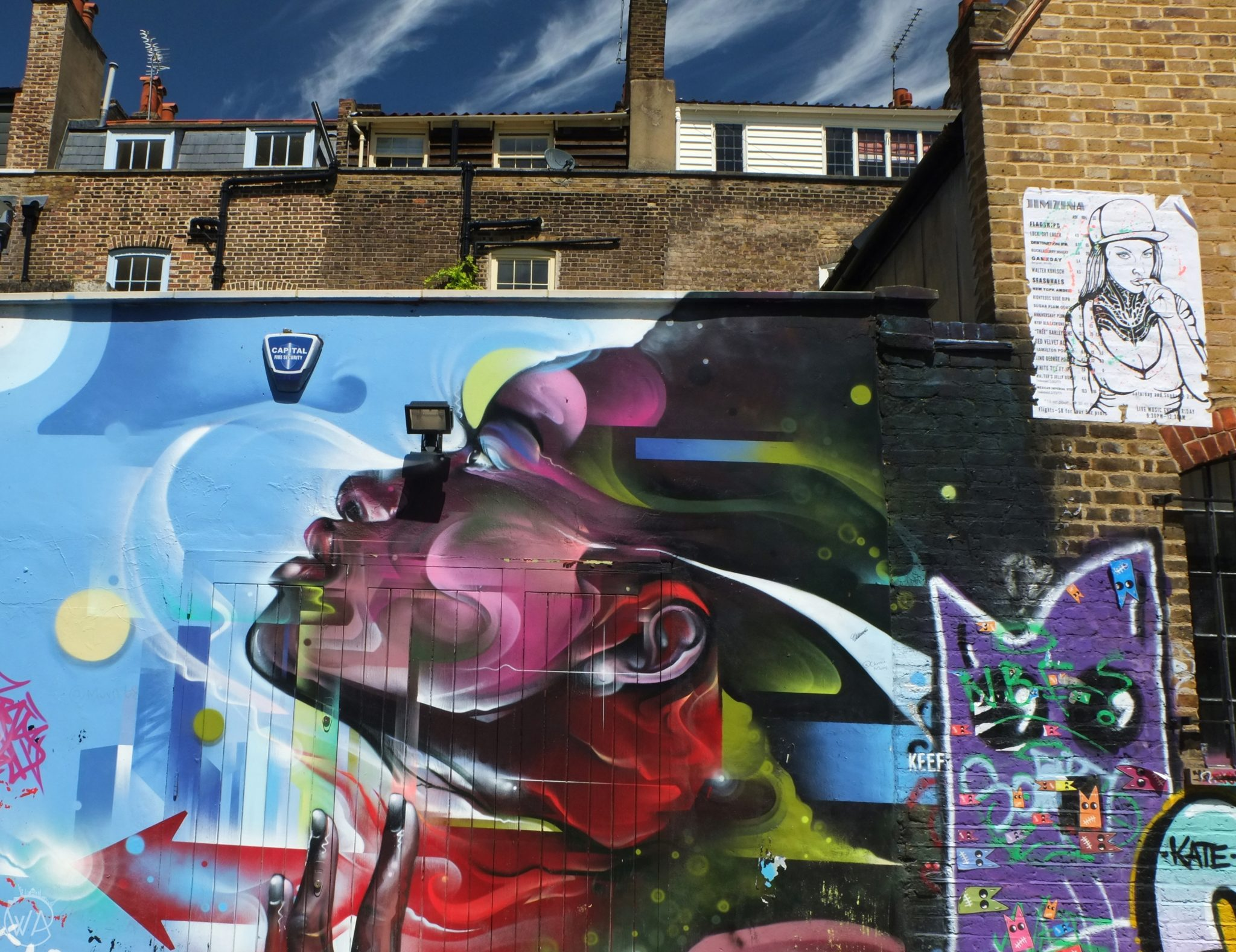 London street art with a colourful girl