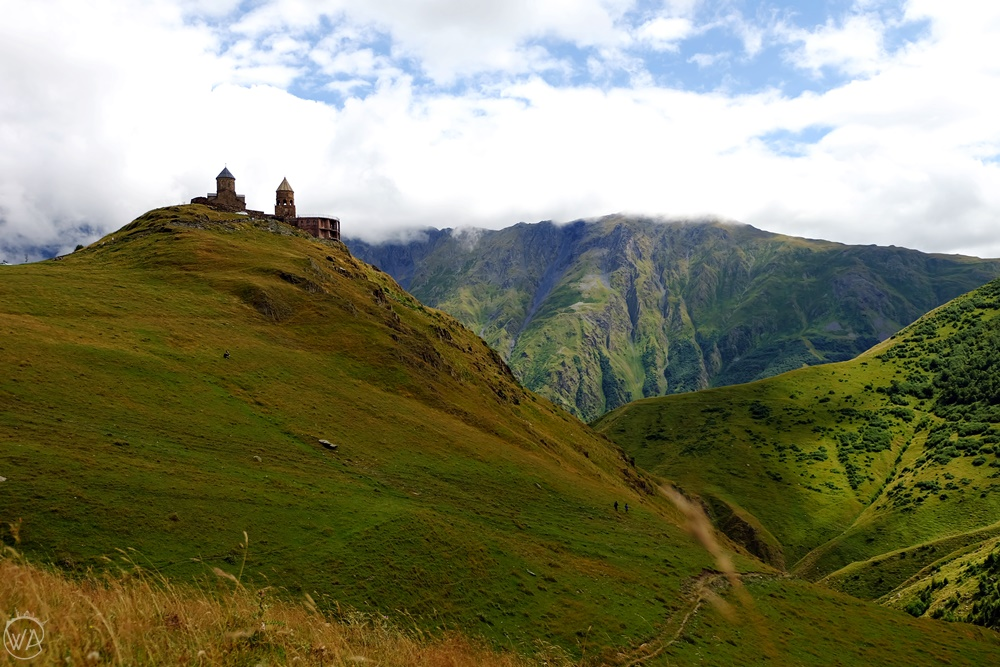 Gergeti Trinity church under mount Kazbegi in Georgia, non touristy holiday destinations to escape the crowds