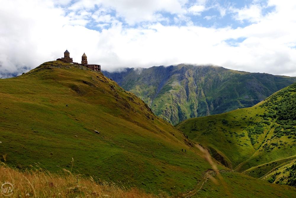 Gergeti Trinity church under mount Kazbegi in Georgia, non touristy holiday destinations to escape the crowds