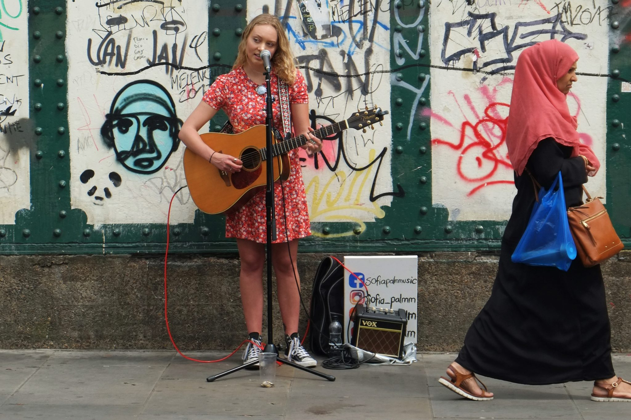 Girl singing in the Brick Lane, London