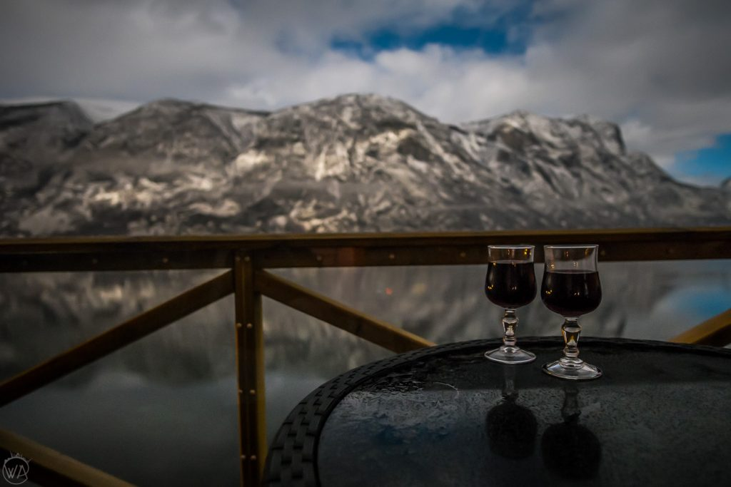Wine glasses with a view to Norwegian fjords in winter, Aurland