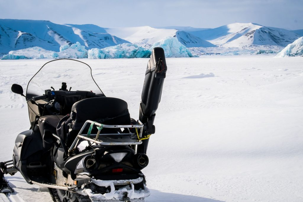 Rifle and snowmobile on Svalbard