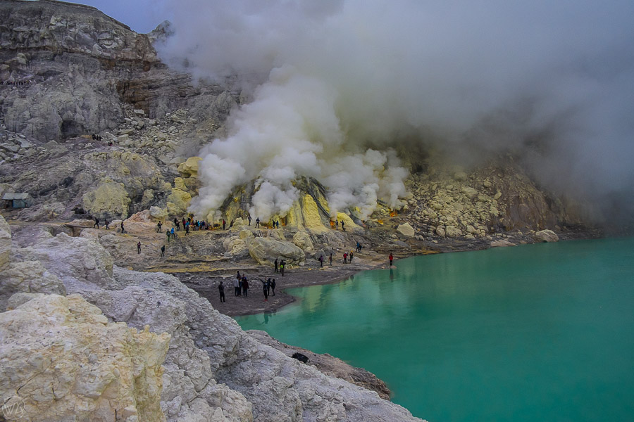 Toxic sulfur gases at the bottom of Kawah Ijen volcano crater during Ijen hike in East Java, Indonesia