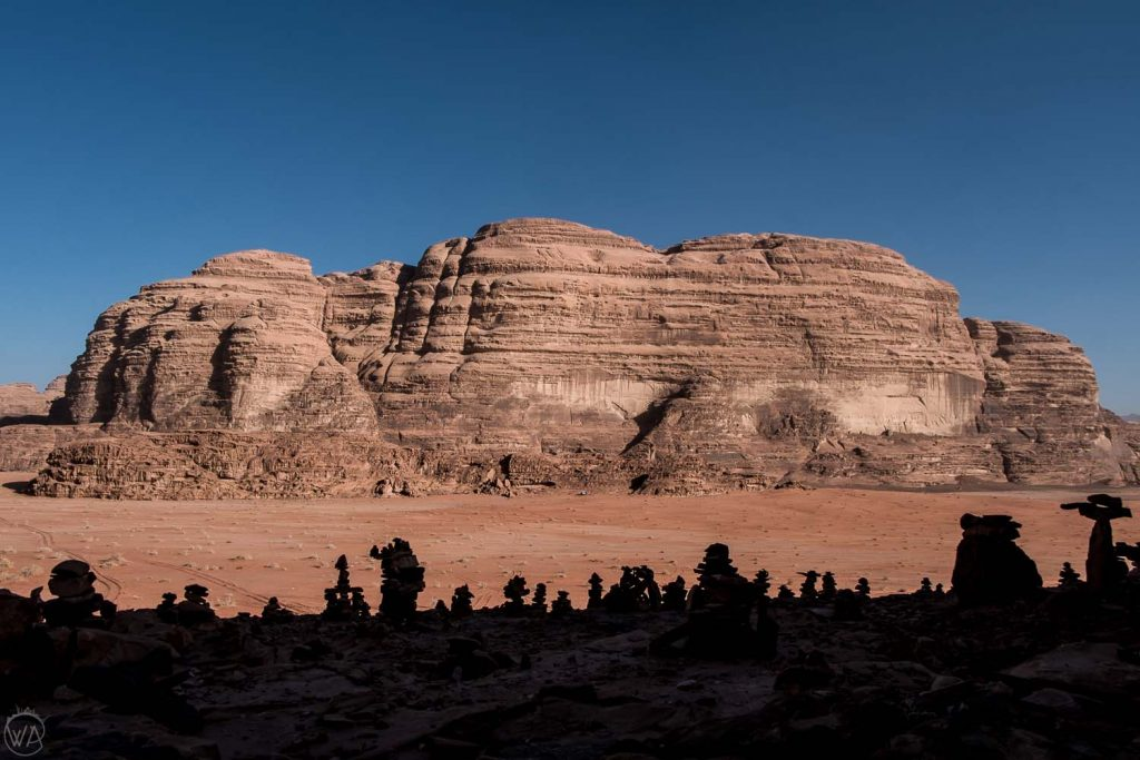 Rock piles in the shadow, looking like aliens. Wadi Rum, Jordan