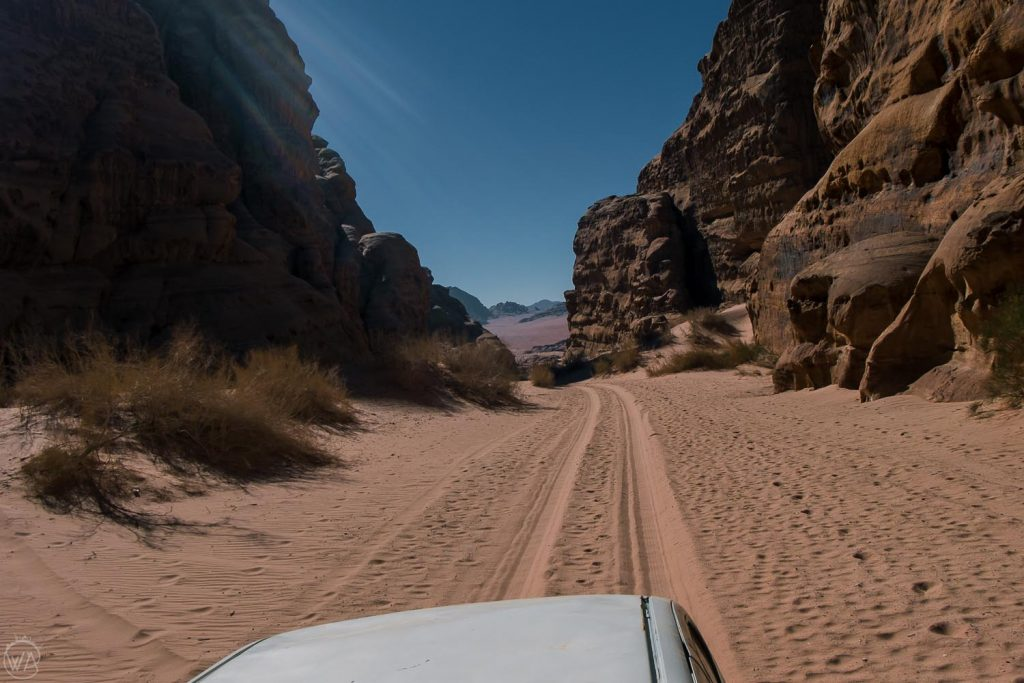 Driving through Wadi Rum to the base of the Jabal Umm ad Dami hike.