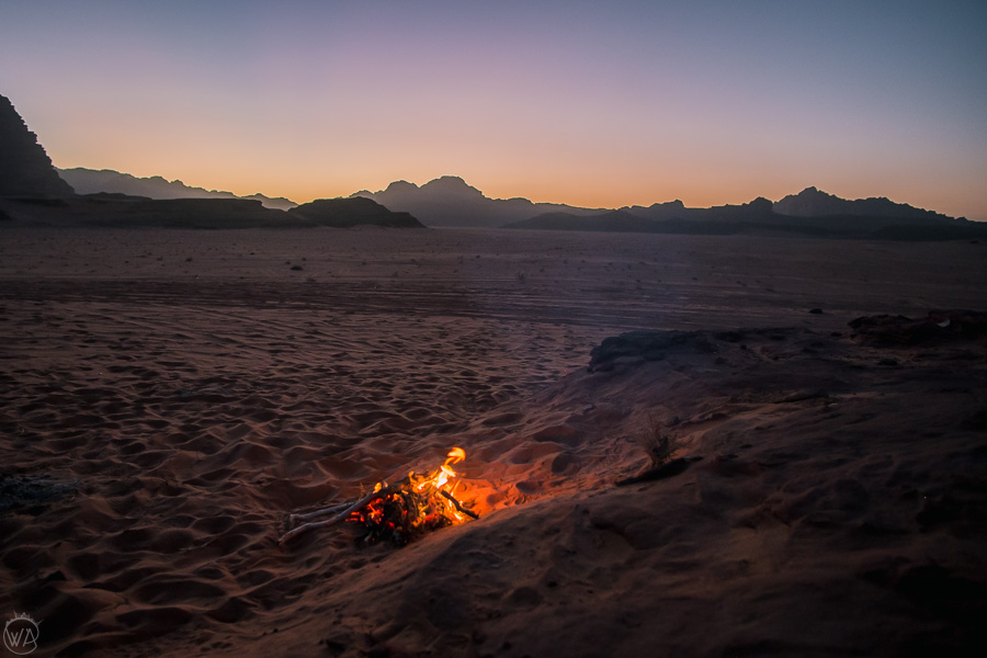 Bonfire in the desert, during sunset, Wadi Rum, Jordan