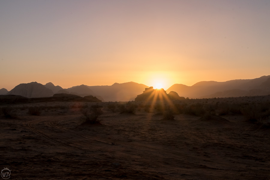 Sun rising over the rock formations in Wadi Rum, Jordan
