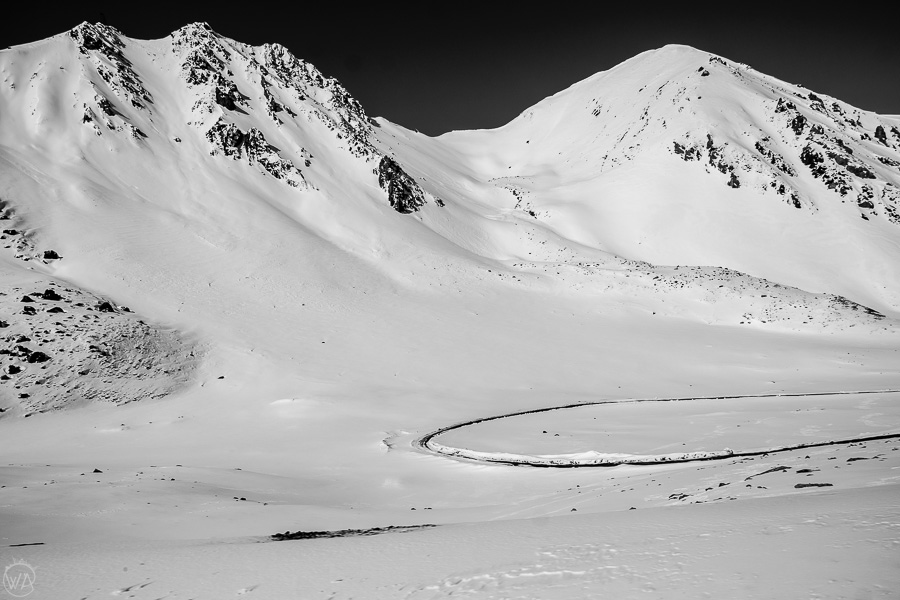 The windy road creating shapes on the snow, Chon-Ashu pass, Tian Shan, Kyrgyzstan