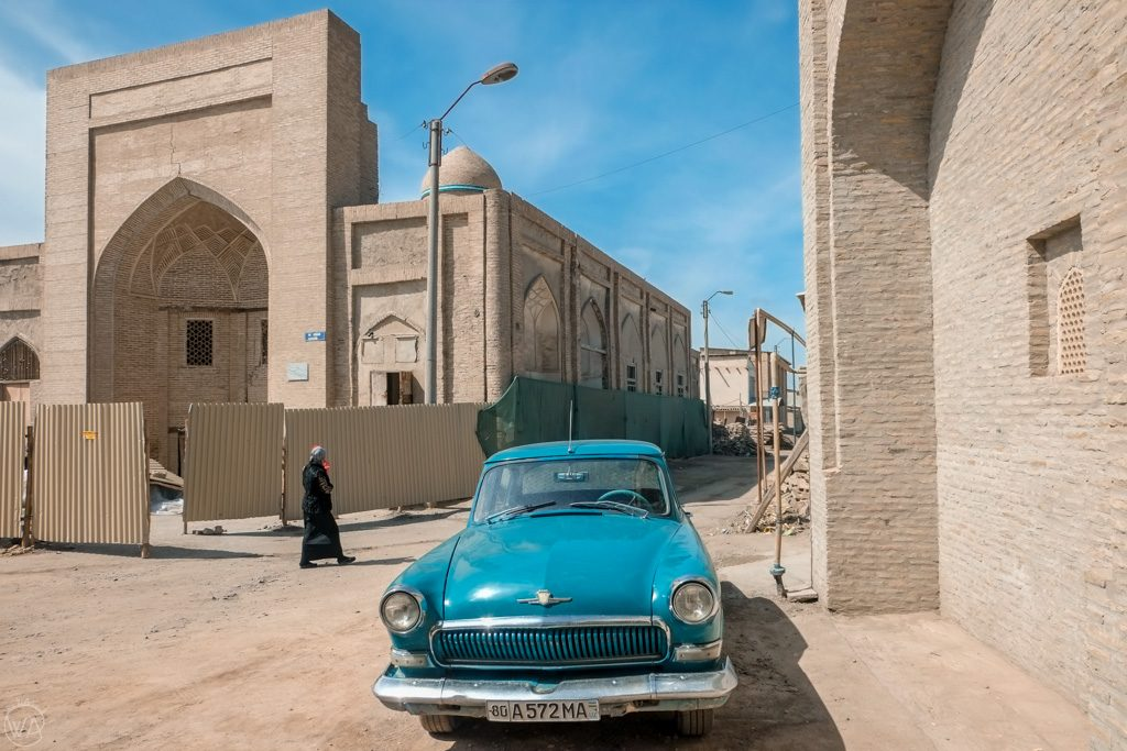 Sandy walls and blue car in Bukhara, Uzbekistan