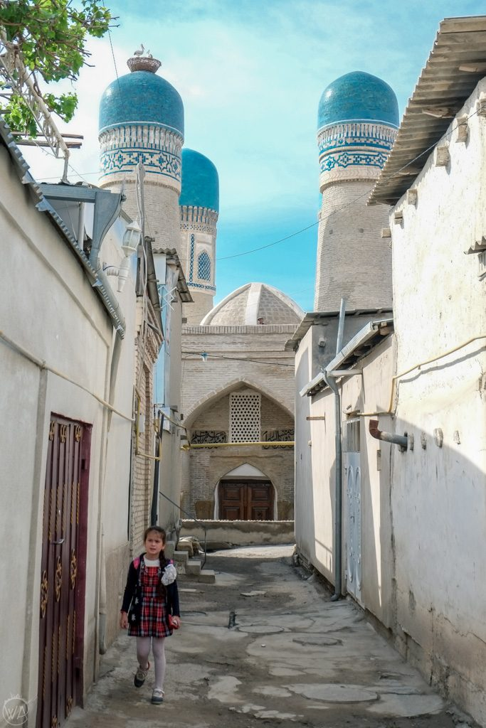 Narrow streets in Bukhara with a view to the Chor Minor, Uzbekistan