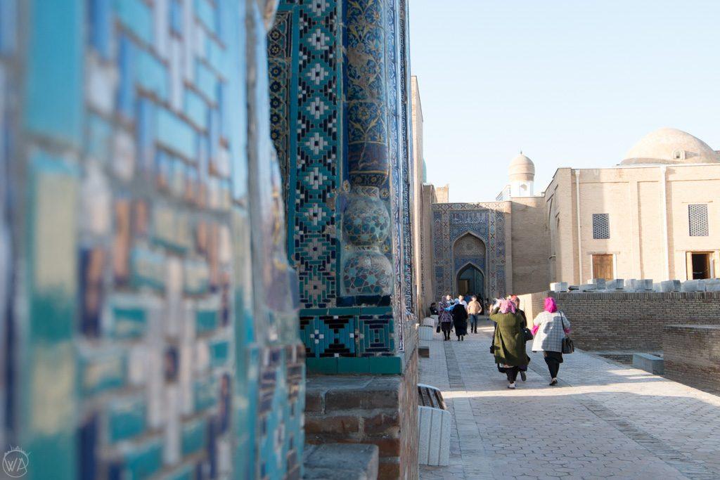 Locals exploring Shah-i-Zinda Necropolis in Samarkand, Uzbekistan