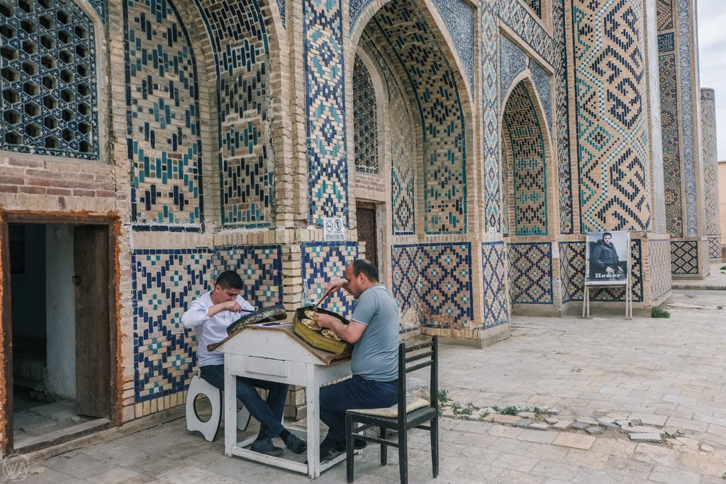 Locals working by the Qo'sh Madrasa, Bukhara, Uzbekistan