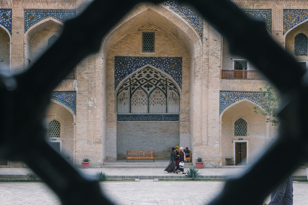 Peaking through into Mir-i-Arab Madrasa in Bukhara, Uzbekistan