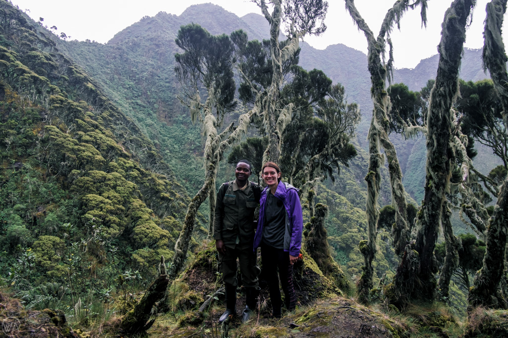 With UWA guide, on Mount Sabyinyo hike in Uganda