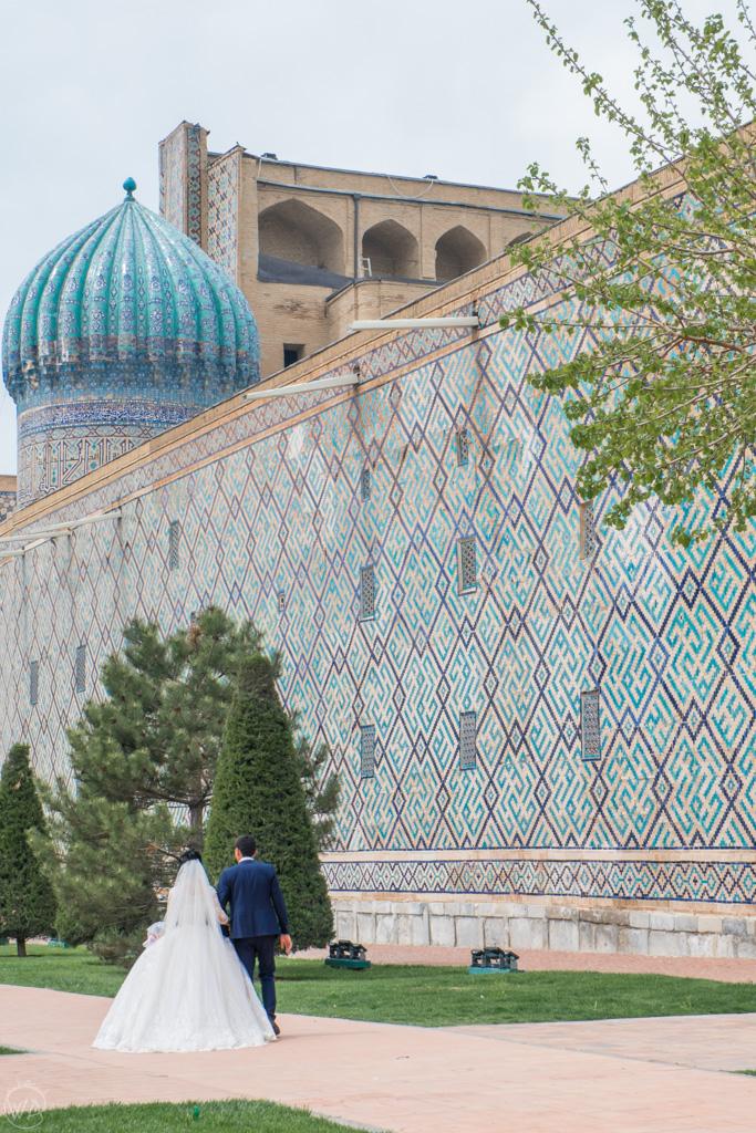 Married couple in front of Registan, Samarkand, Uzbekistan