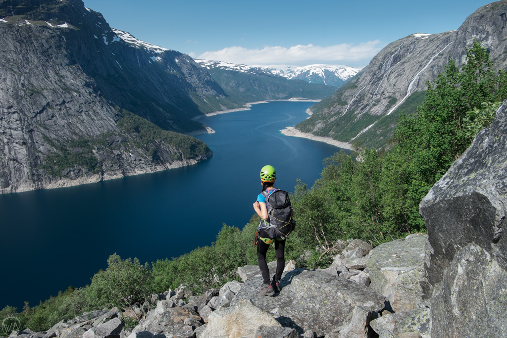 Hiking up the Trolltunga via ferrata with the view of Ringedalsvatnet lake