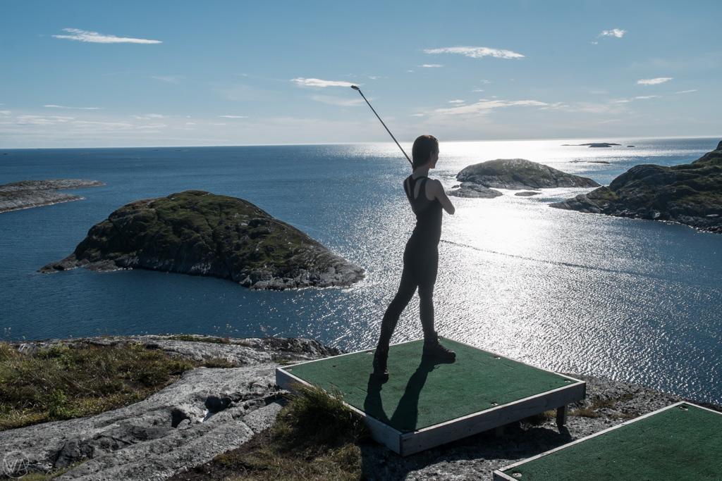 Golfing while feeding fish in Lovund