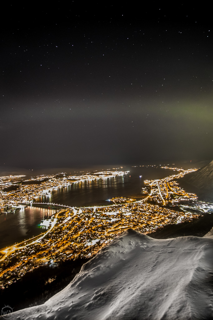 Tromso from above with Northern lights