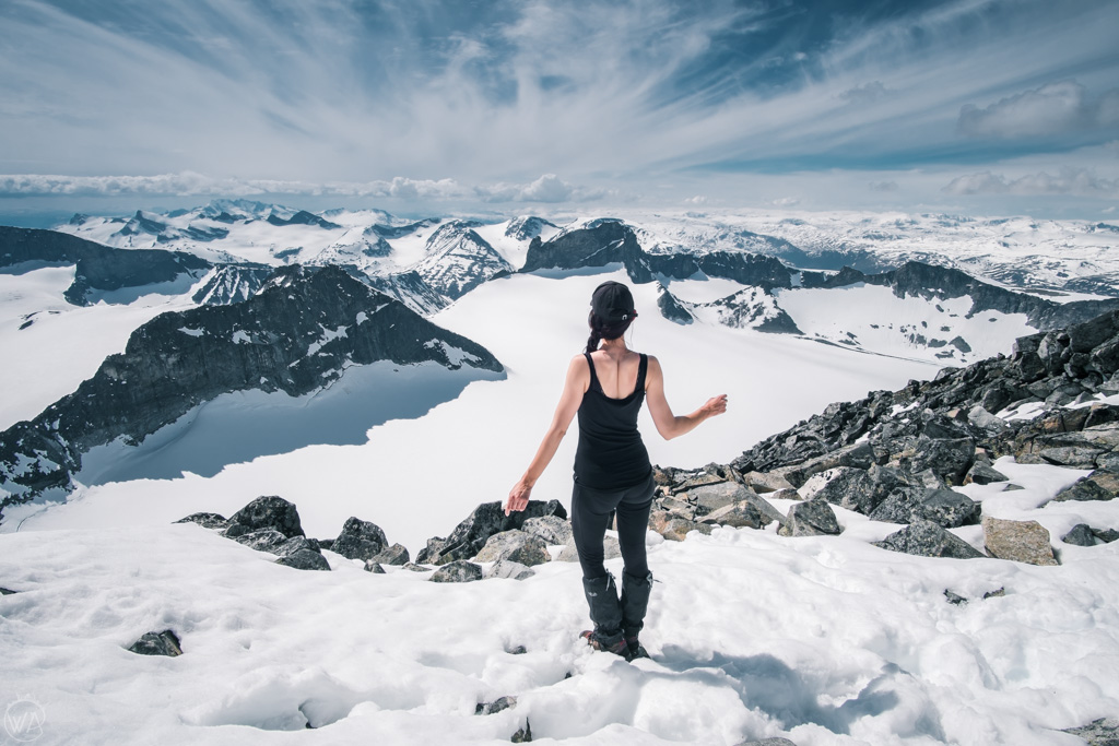A girl on top of Galdhøpiggen, highest mountain in Norway